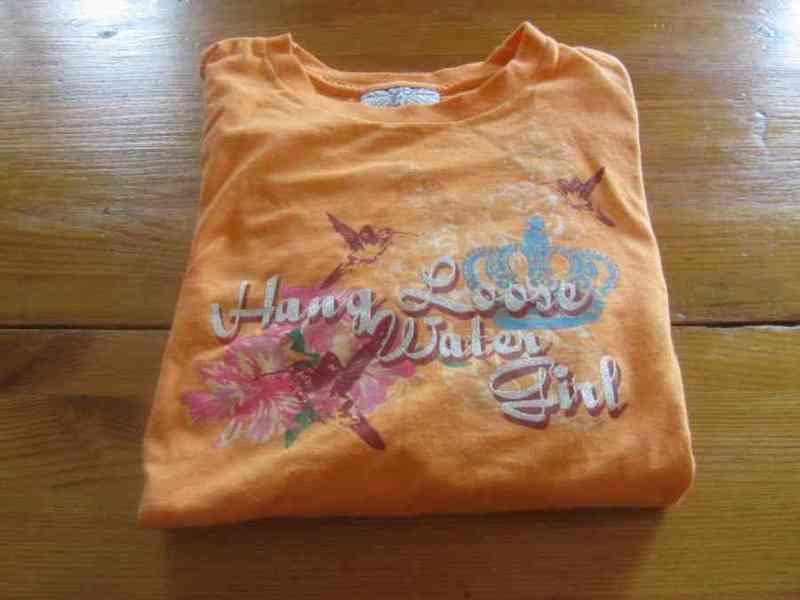 Camiseta naranja .reservada todosirve