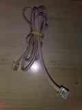 Cable teléfono gris claro