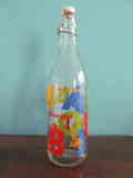 Botella de cristal decorada