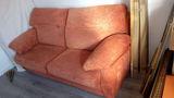 Regalo sofá cama naranja.