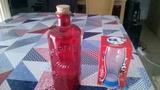 Botella y vaso de cristal nuevos de Coca-Cola