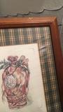 4 cuadros con marcos de madera y láminas antiguas.