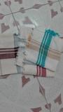 Tres servilletas de varios colores