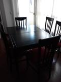 Mesa negra de salon mas 6 sillas