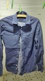 Camisa chico Azul clarito con florecitas. Talla s/2
