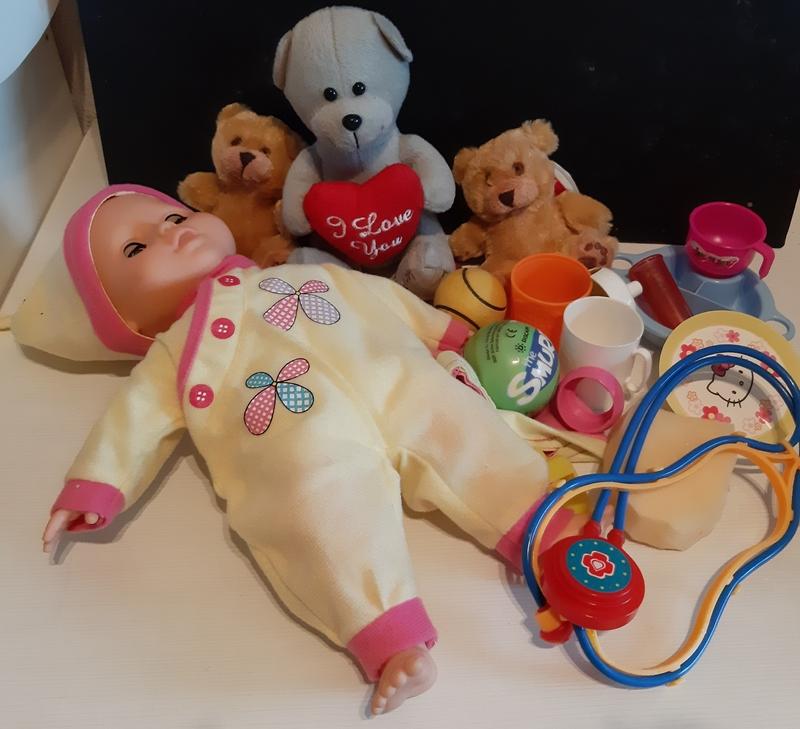 Muñeco y peluches